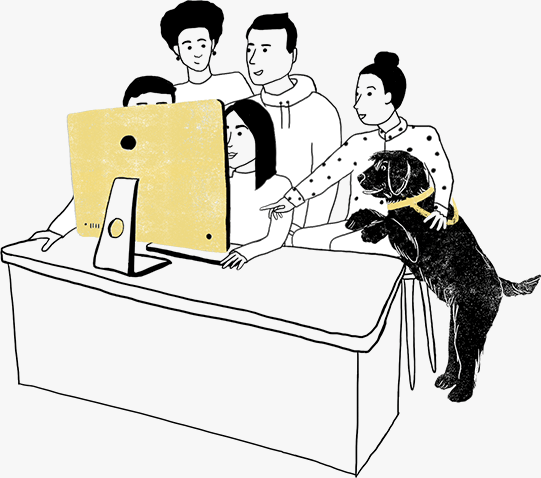 Workers and dog huddled around woman at desk