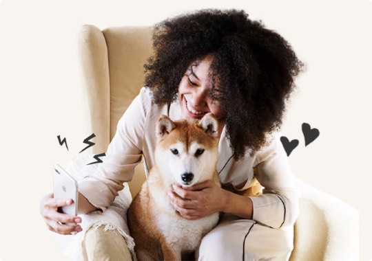 Woman on phone with dog