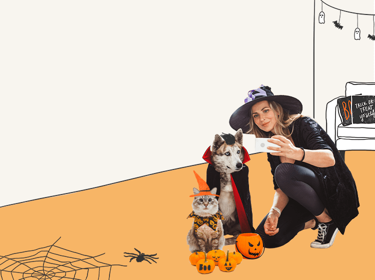 Woman with pets in halloween costumes